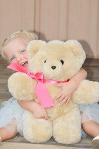 Millie jsut loves huggin her Tambo Teddy Bear