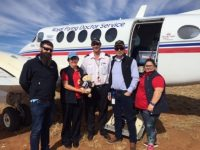 Tambo Teddy Buckland Bill with the crew from the royal flying doctor service
