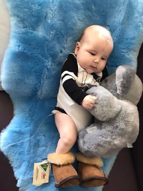 Baby Austin with his Tambo Teddy and sheepie